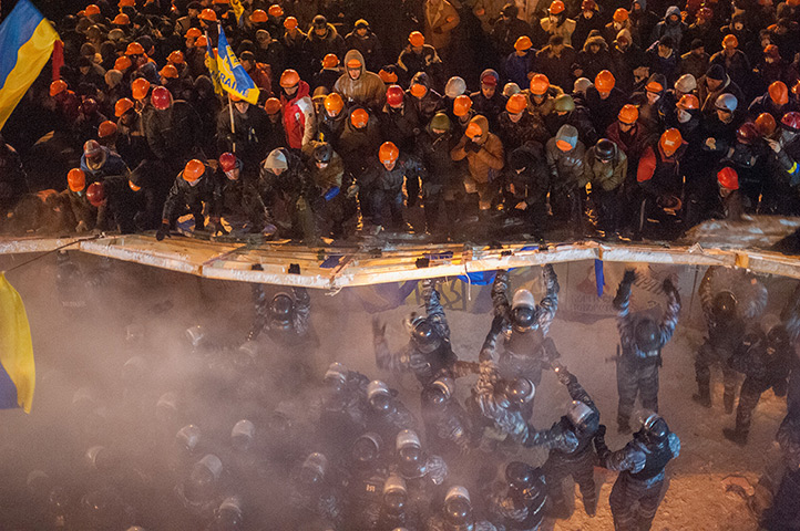 Demonstrators clash with riot police officers at Maidan, Kiev's central squ